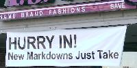 Partially obscured sign, New Markdowns Just Take.