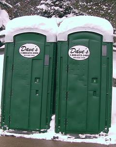 Portable toilets with the name Dave's on them