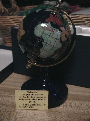 Desk globe with disclaimer note