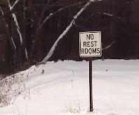 Sign, No Rest Rooms, in the middle of the woods.