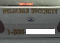 Sign on private security car:  Reliable Security.